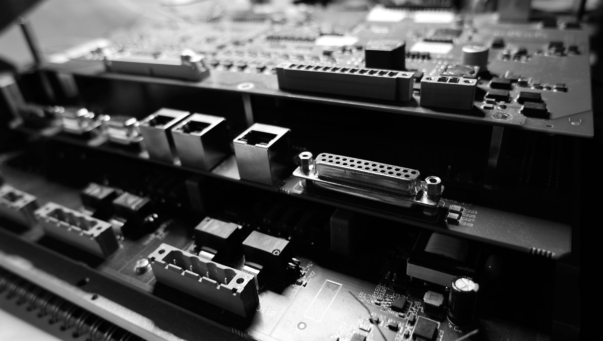 Stacked up circuit boards with many electronic components.